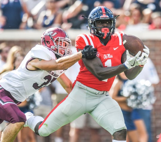 Mississippi wide receiver A.J. Brown (1) scores on a 38 yard pass reception against Southern Illinois safety Michael Elbert (37) during an NCAA college football game at Vaught-Hemingway Stadium in Oxford, Miss. on Saturday, Sept. 8, 2018. (Bruce Newman/The Oxford Eagle via AP)