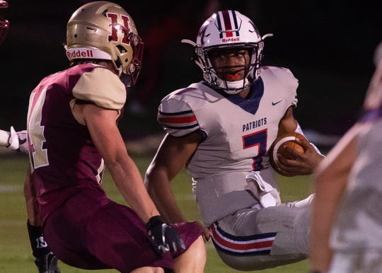Madison Ridgeland Academy quarterback Phillip Short (7) tries to avoid Hartield Academy's Jake Jesiolowski (14) during game action Friday September 7th, 2018 in Flowood, MS (Bob Smith/For the Clarion Ledger)