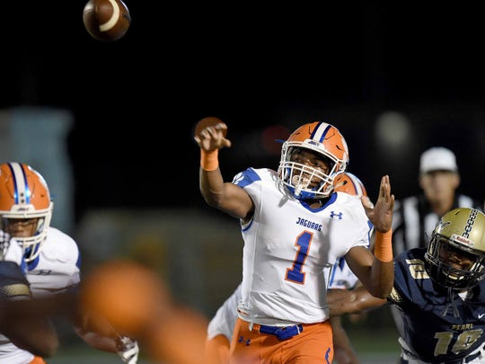 Madison Central's Jimmy Holiday (1) throws deep against Pearl on Friday, September 7, 2018, at Pearl High School in Pearl, Miss.
