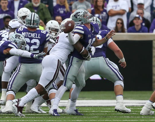 Mississippi State's Leo Lewis (10) hits Kansas State's Skylar Thompson (10) on a play that was originally ruled as a fumble, but later overturned. Mississippi State and Kansas State played in a college football game on Saturday, September 8, 2018, in Manhattan, Kansas. Photo by Keith Warren/Madatory Photo Credit