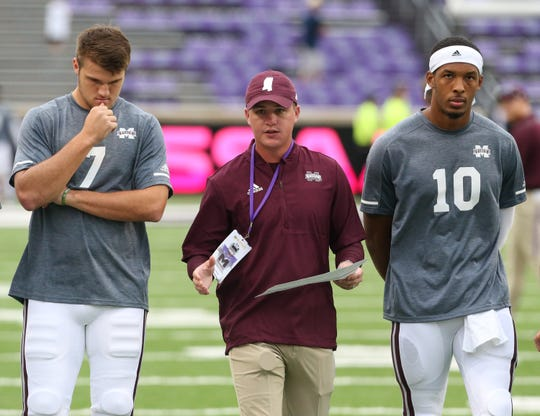 Mississippi State's Nick Fitzgerald (7) and Mississippi State's Keytaon Thompson (10) talk with Andrew Breiner, MSU pass game coordinator/quarterbacks coach prior to the game. Mississippi State and Kansas State played in a college football game on Saturday, September 8, 2018, in Manhattan, Kansas. Photo by Keith Warren/Madatory Photo Credit