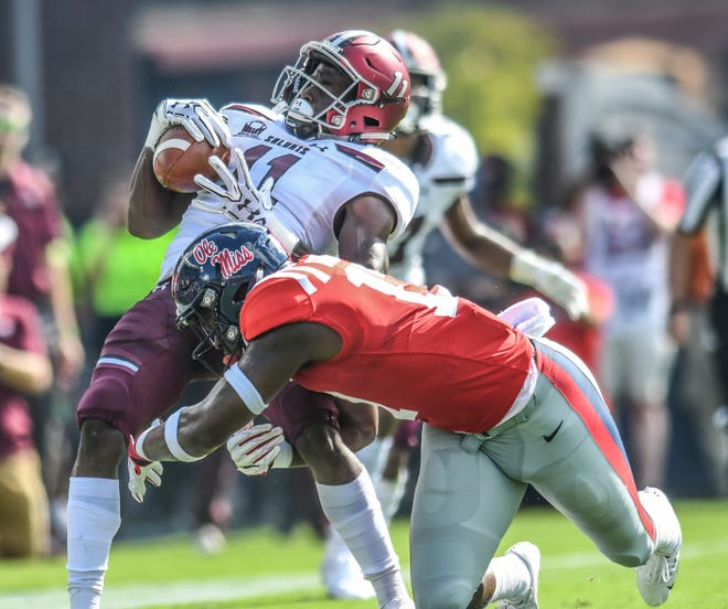 Southern Illinois wide receiver Raphael Leonard (11) is tackled by Mississippi linebacker Willie Hibbler (17) during an NCAA college football game at Vaught-Hemingway Stadium in Oxford, Miss. on Saturday, Sept. 8, 2018. (Bruce Newman/The Oxford Eagle via AP)