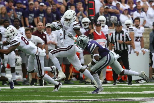 Sep 8, 2018; Manhattan, KS, USA; Mississippi State Bulldogs wide receiver Stephen Guidry (1) runs past Kansas State Wildcats defensive back Walter Neil Jr. (15) during the first quarter at Bill Snyder Family Stadium. Mandatory Credit: Scott Sewell-USA TODAY Sports