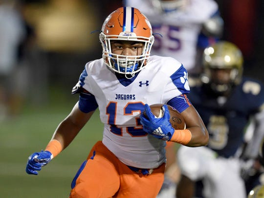 Madison Central's Duke Arnold (13) heads upfield against Pearl on Friday, September 7, 2018, at Pearl High School in Pearl, Miss.