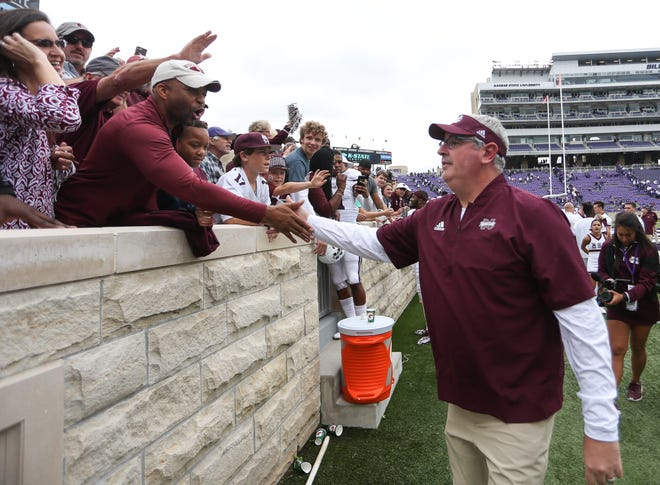 Mississippi State head coach Joe Moorhead shakes hands with MSU fans following the game. Mississippi State and Kansas State played in a college football game on Saturday, September 8, 2018, in Manhattan, Kansas. Photo by Keith Warren/Madatory Photo Credit