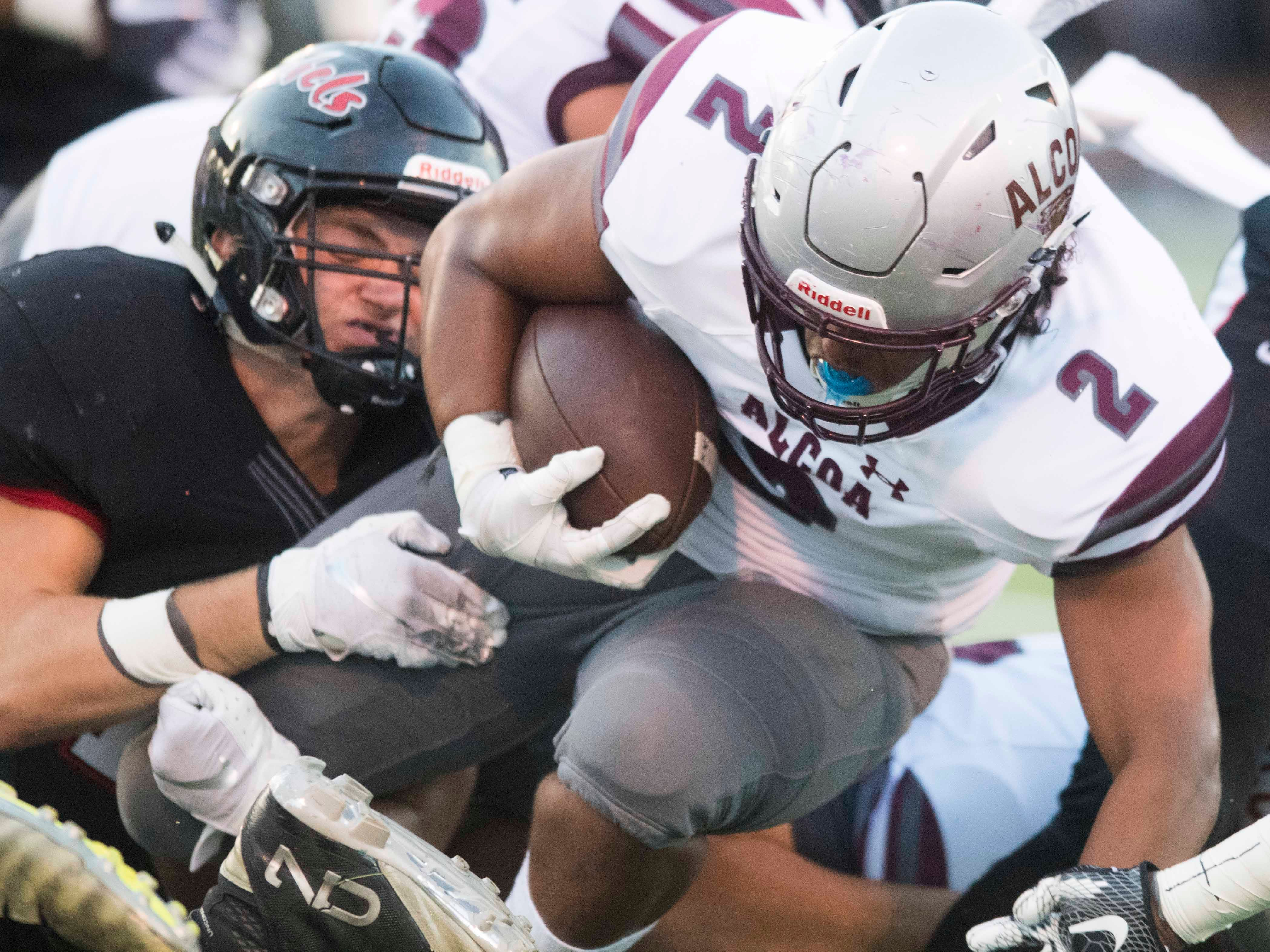 Alcoa's K'Vaughn Tyson (2) is tackled by Maryville's Spencer Shore (11) in the football game on Friday, September 7, 2018.