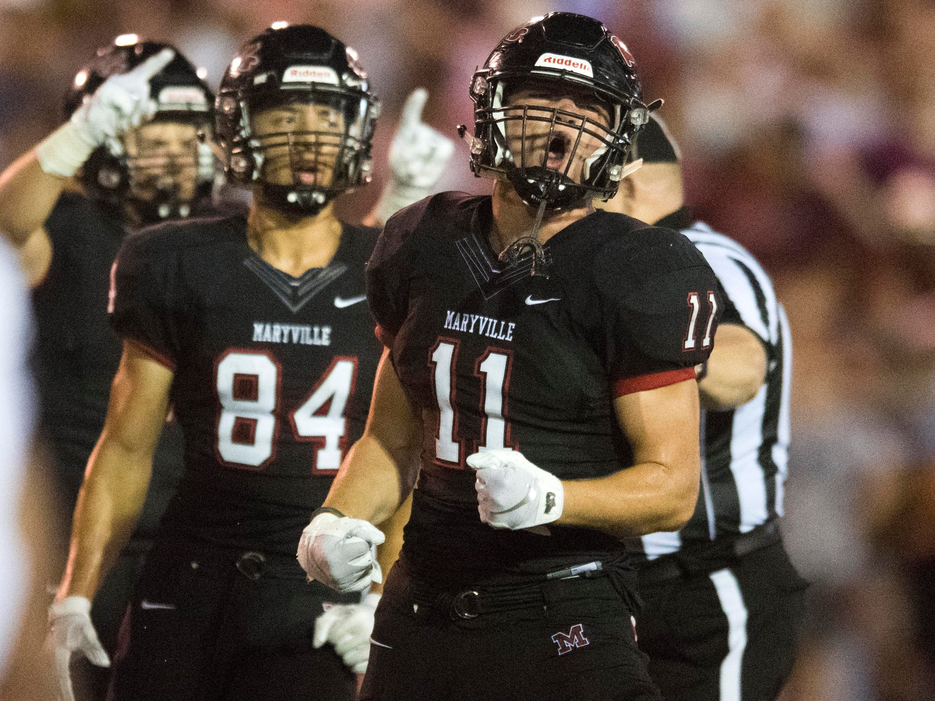 Maryville's Spencer Shore (11) celebrates after a play during the football game against Alcoa on Friday, September 7, 2018.