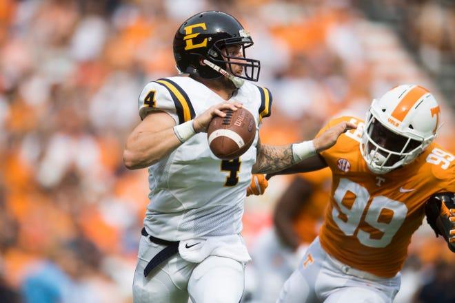 Tennessee linebacker Jonathan Kongbo (99) pursues ETSU quarterback Logan Marchi (4) during Saturday's game.