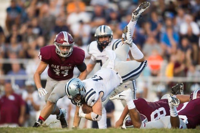 Farragut's Kyle Carter (15) flies through the air with the ball during a high school football game between Oak Ridge and Farragut at Oak Ridge Friday, Sept. 7, 2018. Farragut won, 20-14.