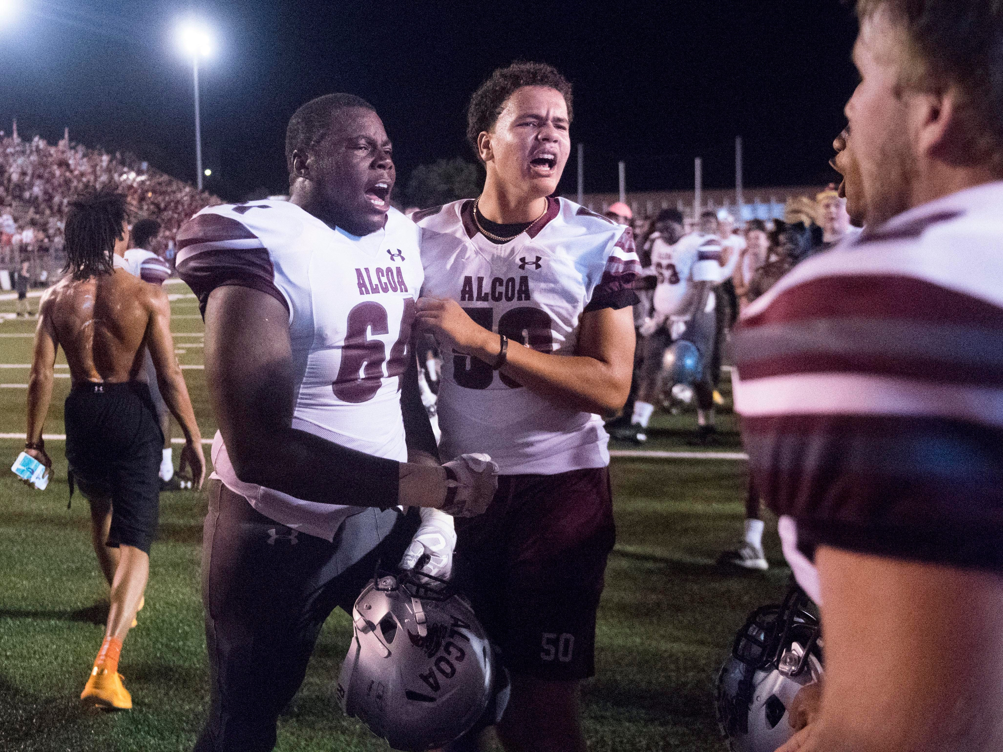 Alcoa players Malik Hall (64) and Daunte Asbury (50) celebrate after their victory over Maryville on Friday, September 7, 2018.