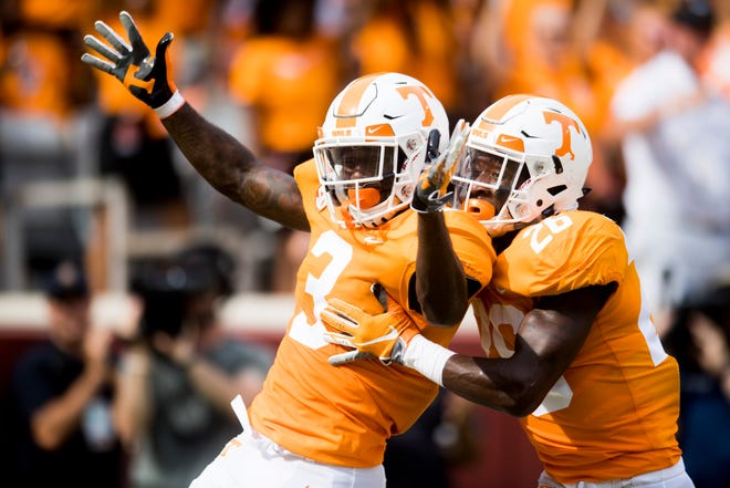 Tennessee defensive back Marquill Osborne (3) scores a touchdown as Tennessee defensive back Theo Jackson (26) congratulates him during a game between Tennessee and ETSU at Neyland Stadium in Knoxville, Tennessee on Saturday, September 8, 2018.