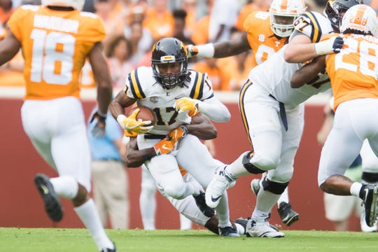 ETSU wide receiver Quan Harrison (17) ties to break through the Tennessee defense during a game between Tennessee and ETSU at Neyland Stadium in Knoxville, Tennessee on Saturday, September 8, 2018.