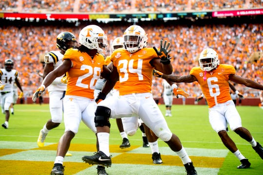 Tennessee linebacker Darrin Kirkland Jr. (34) makes a touchdown during a game between Tennessee and ETSU at Neyland Stadium in Knoxville, Tennessee on Saturday, September 8, 2018.