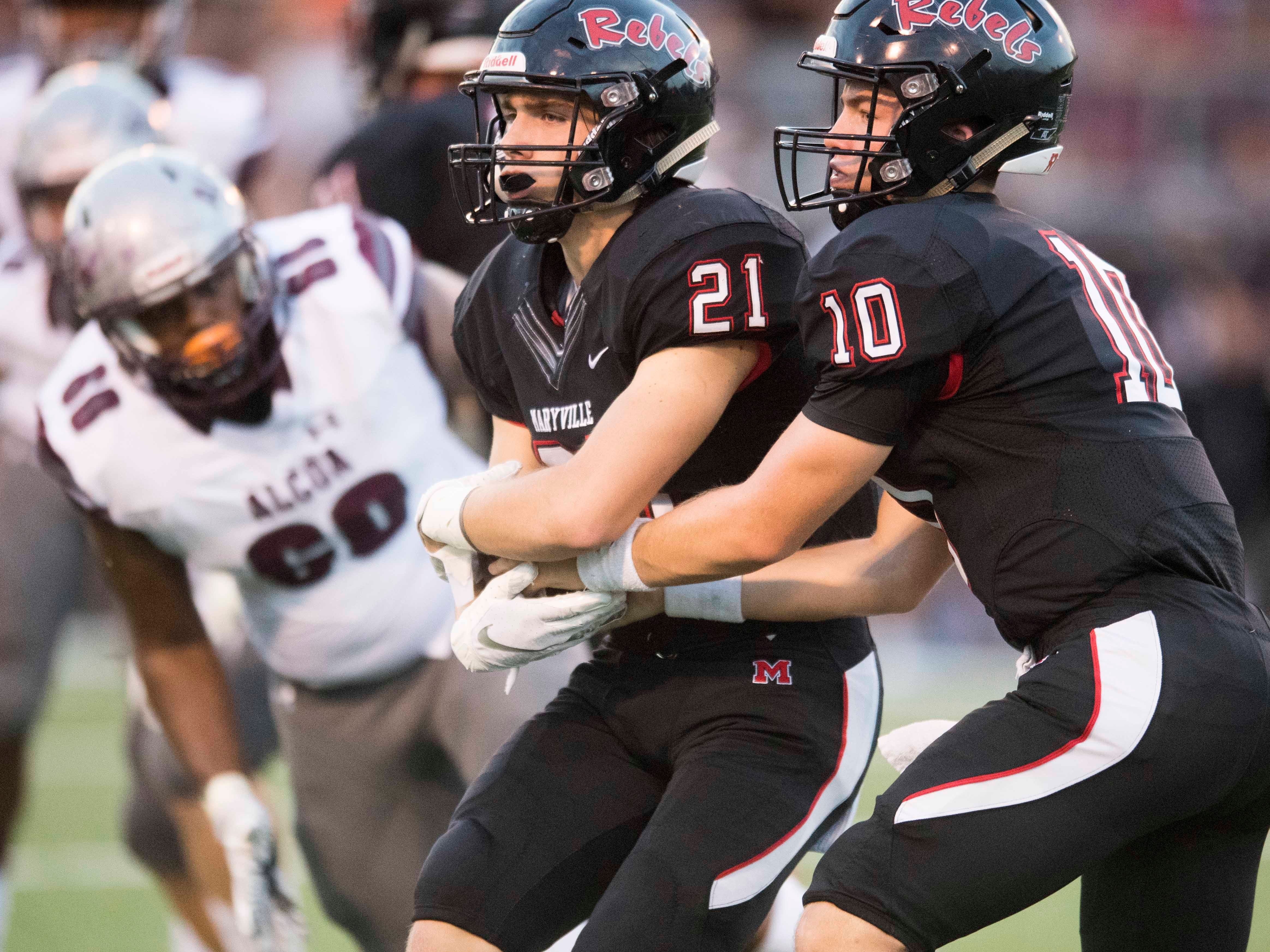 Maryville's Braden Carnes (10) hands the ball off to Bryson Teffeteller (21) in the football game at Maryville on Friday, September 7, 2018.