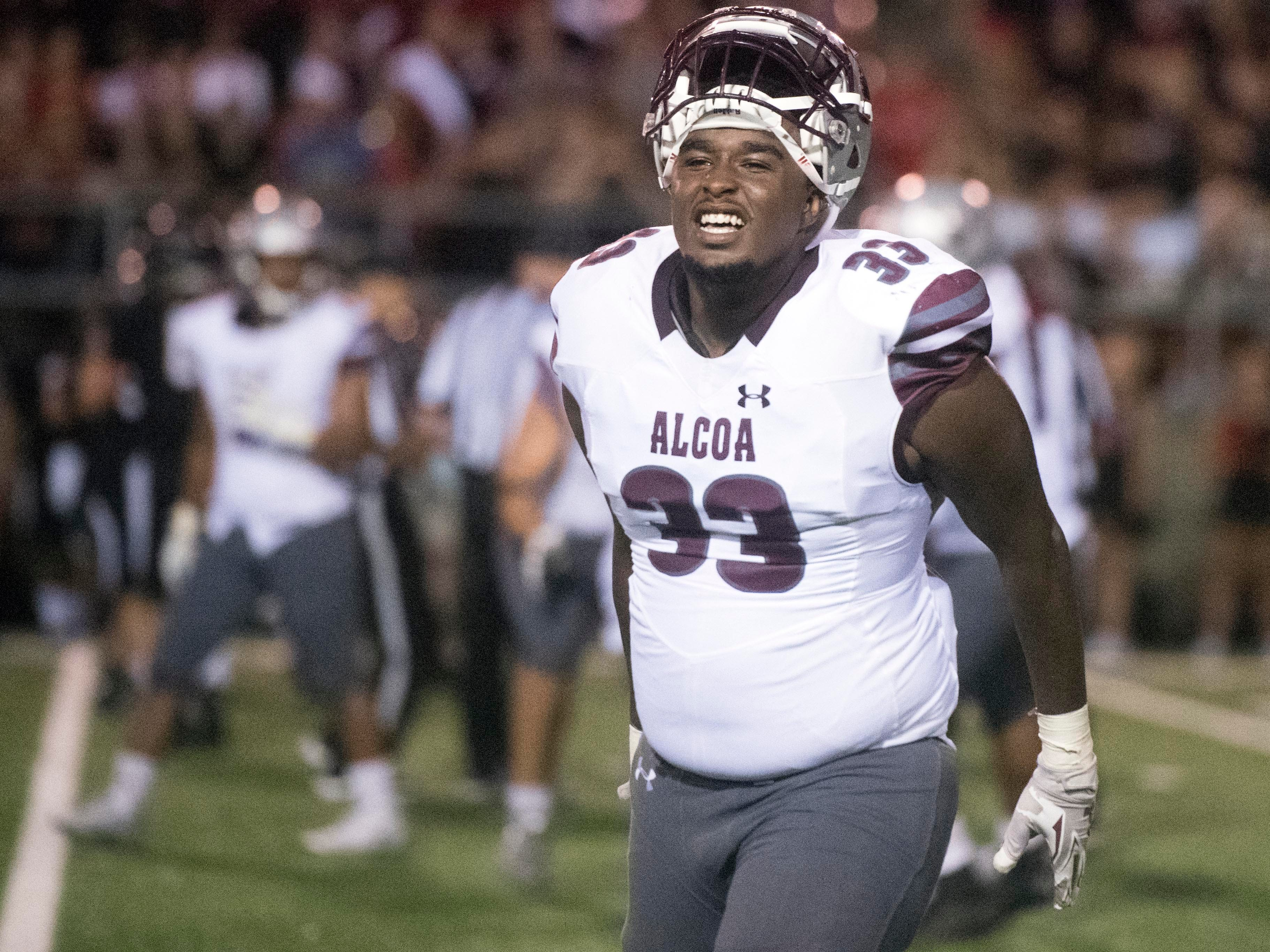 Alcoa's Adonis Salter (33) celebrates as Alcoa secures the win against Maryville on Friday, September 7, 2018.