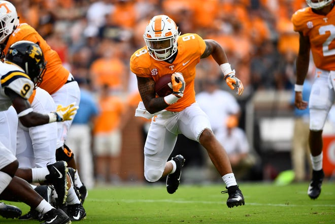 Tennessee running back Tim Jordan (9) carries the ball against ETSU on Saturday at Neyland Stadium.
