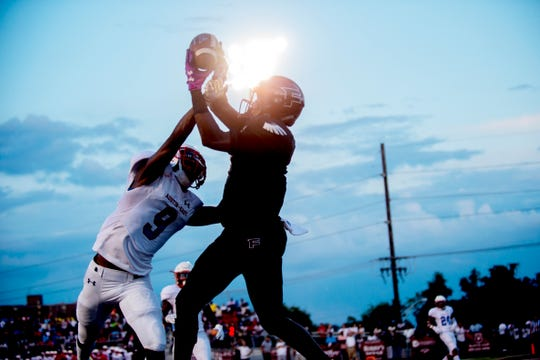 Fulton's DaShaun McKinney (8) and Austin-East's Elijah Jeter (9) try to catch a pass in the end zone during a football game between Fulton and Austin-East at Fulton High School in Knoxville, Tennessee on Friday, September 7, 2018.
