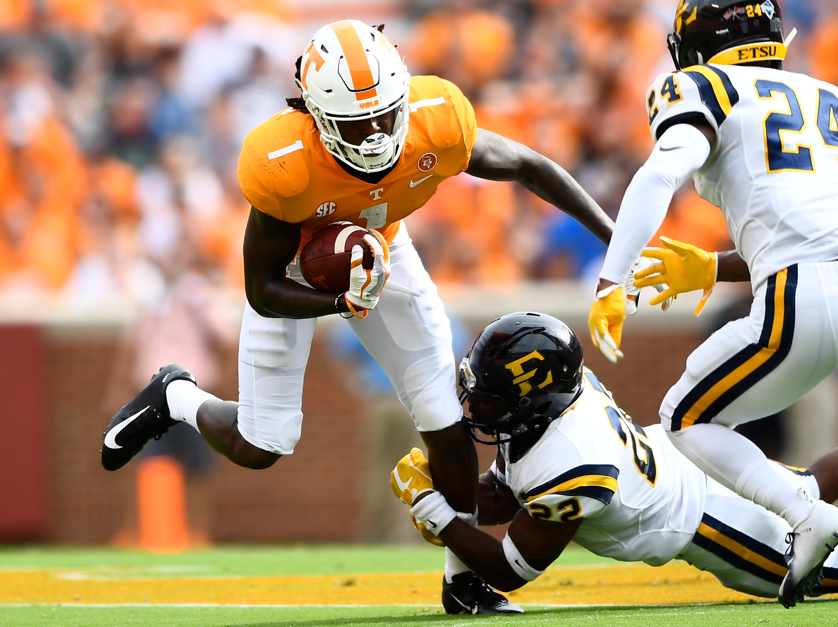 Tennessee wide receiver Marquez Callaway (1) is tripped up by ETSU linebacker Zack Yancey (22) during a game between Tennessee and ETSU at Neyland Stadium in Knoxville, Tennessee on Saturday, September 8, 2018.