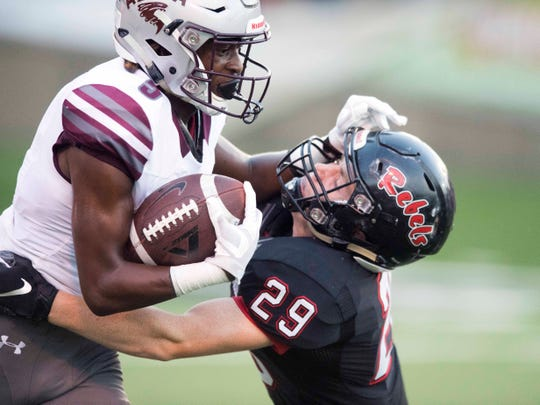 Alcoa's C.J. Armstrong (5) tried to fend off Maryville's Will Myers (29) in the football game at Maryville on Friday, September 7, 2018.