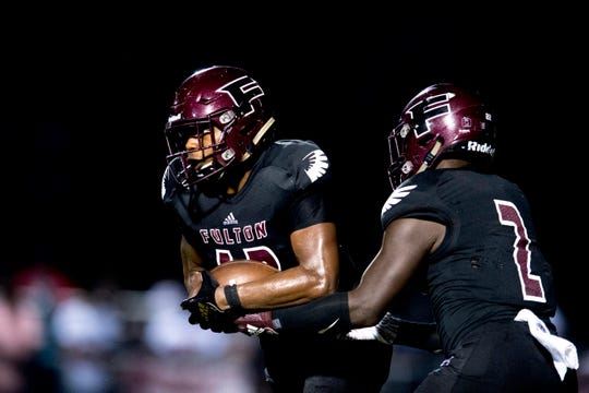 Fulton's J'Coryan Anderson (12) is handed the ball by Fulton's JaShaun Fenderson (2) during a football game between Fulton and Austin-East at Fulton High School in Knoxville, Tennessee on Friday, September 7, 2018.