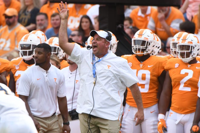 Tennessee Head Coach Jeremy Pruitt calls during a game between Tennessee and ETSU at Neyland Stadium in Knoxville, Tennessee on Saturday, September 8, 2018.
