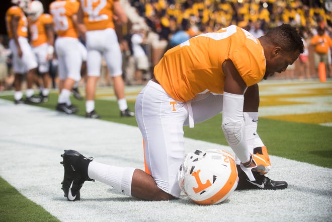 A Vols player ties his shoe before a Tennessee Vols football game against ETSU inside Neyland Stadium Saturday, Sept. 8, 2018.