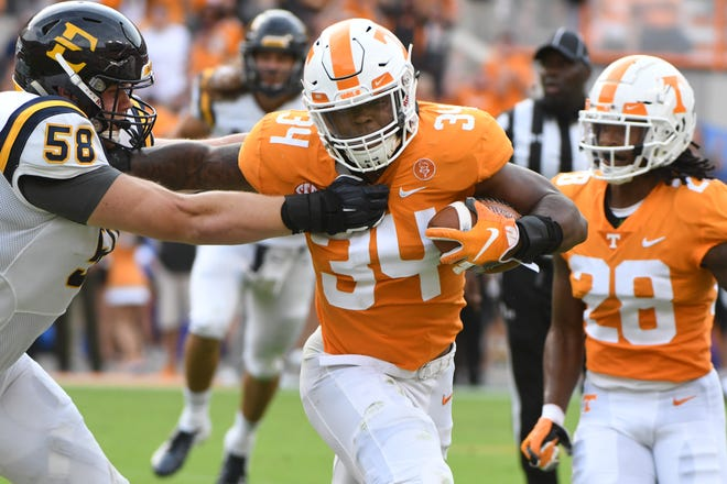 Tennessee linebacker Darrin Kirkland Jr. (34) pushes away ETSU offensive lineman Greg McCloud (58) during a game between Tennessee and ETSU at Neyland Stadium in Knoxville, Tennessee on Saturday, September 8, 2018.