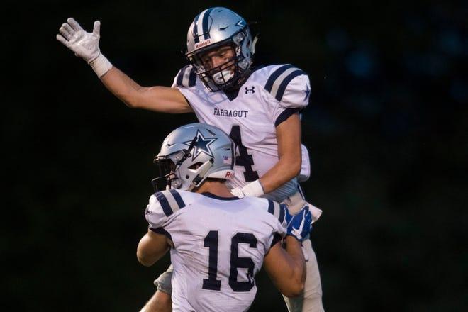 Farragut's Jon Buell (4) congratulates Farragut's Tanner Corum (16) on a touch down during a high school football game between Oak Ridge and Farragut at Oak Ridge Friday, Sept. 7, 2018. Farragut won, 20-14.