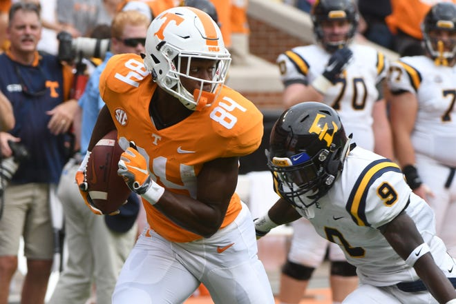 Tennessee wide receiver Josh Palmer (84) runs with the ball as ETSU defensive back Karon Delince (9) goes for a tackle during a game between Tennessee and ETSU at Neyland Stadium in Knoxville, Tennessee on Saturday, September 8, 2018.