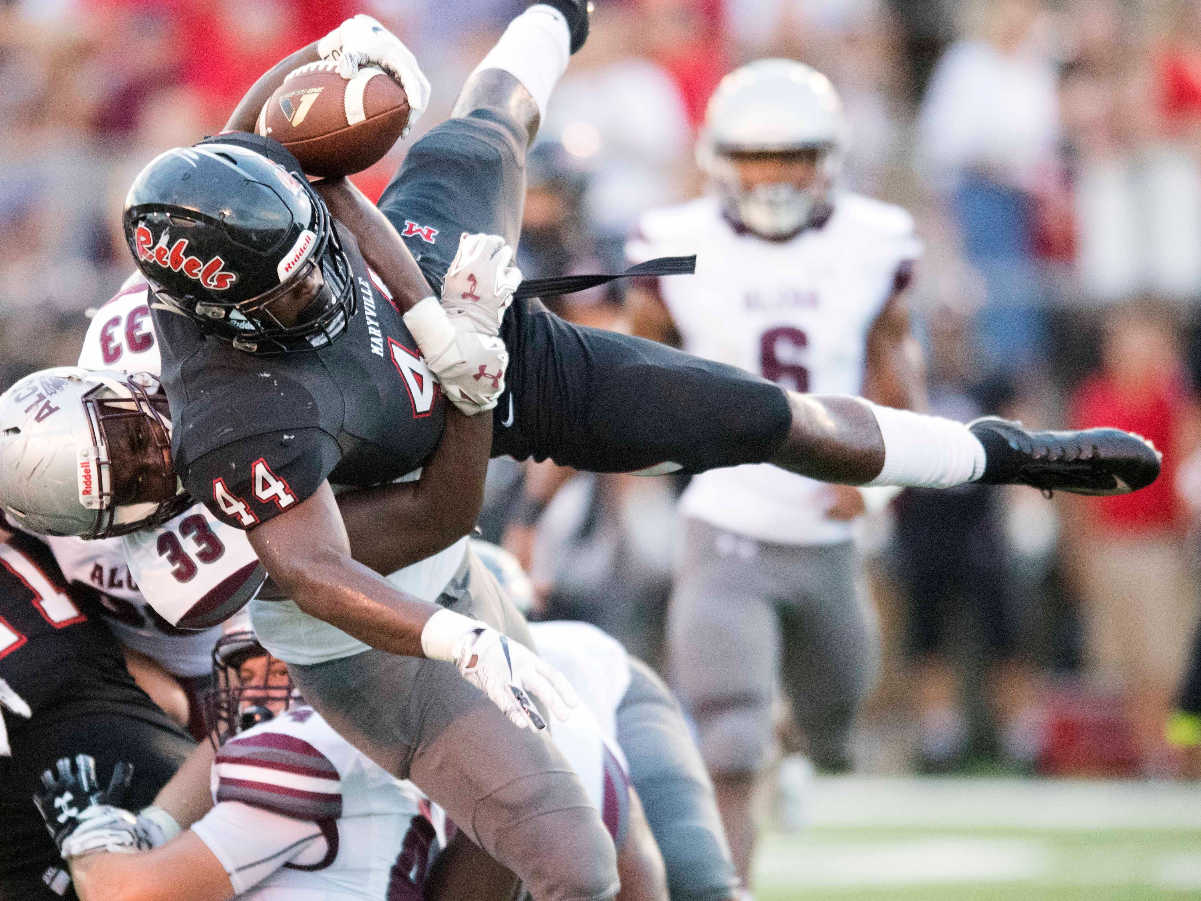 Alcoa's Adonis Salter (33) tackles Maryville's Tee Hodge (44) during the football game at Maryville on Friday, September 7, 2018.