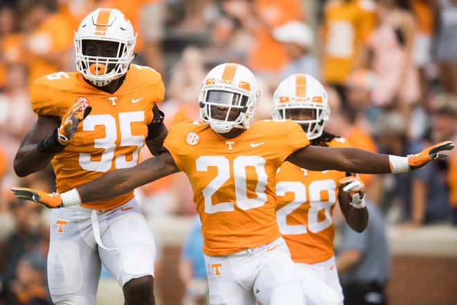 Tennessee defensive back Bryce Thompson (20) celebrates a play alongside Tennessee linebacker Daniel Bituli (35) and Tennessee defensive back Baylen Buchanan (28)  during a game between Tennessee and ETSU atNeyland Stadium in Knoxville, Tennessee on Saturday, September 8, 2018.