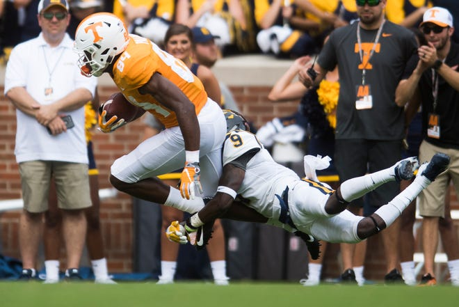 Tennessee wide receiver Josh Palmer (84) is tackled by ETSU defensive back Karon Delince (9).