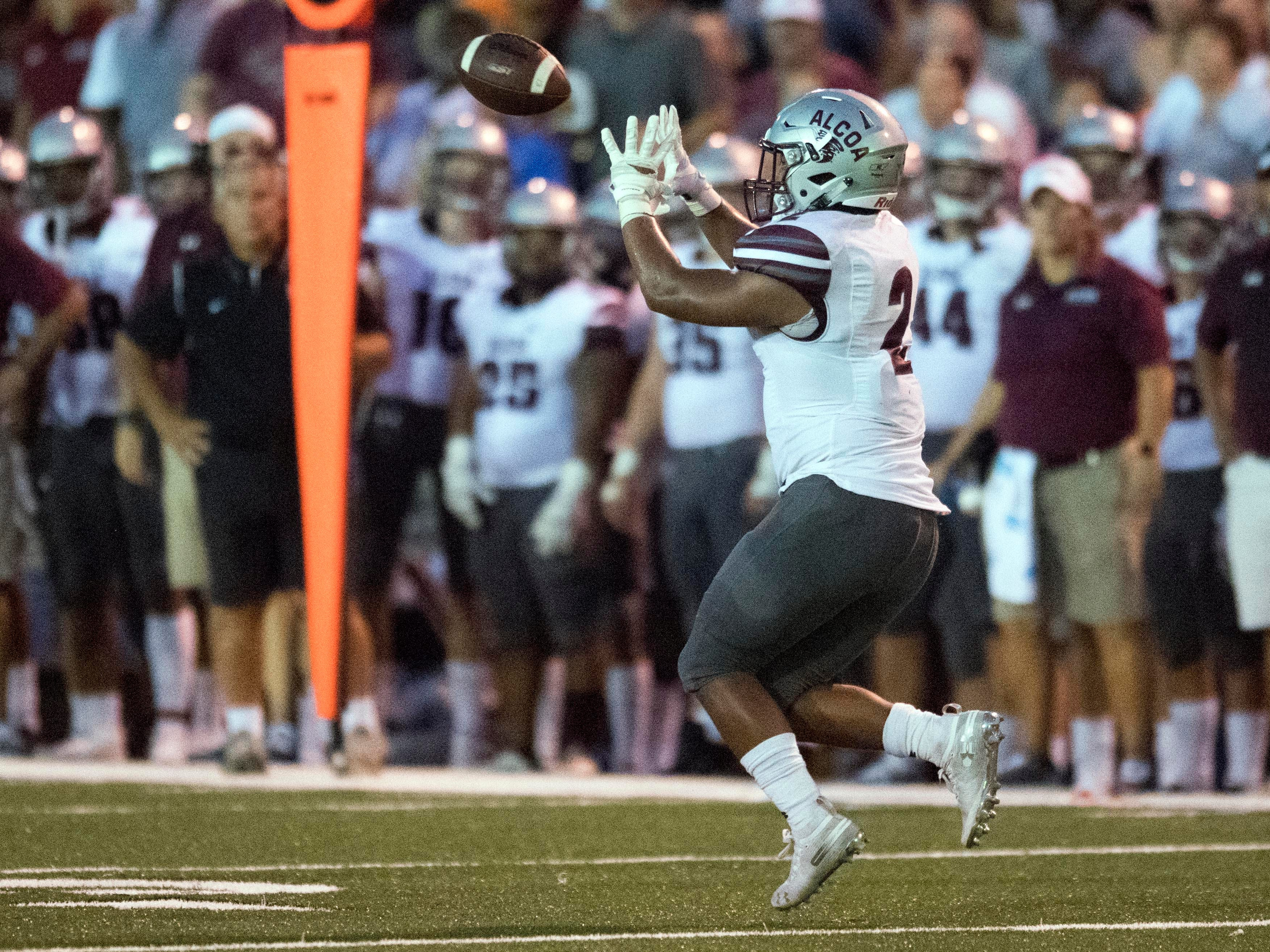 Alcoa's K'Vaughn Tyson (2) makes the catch in the football game against Maryville on Friday, September 7, 2018.