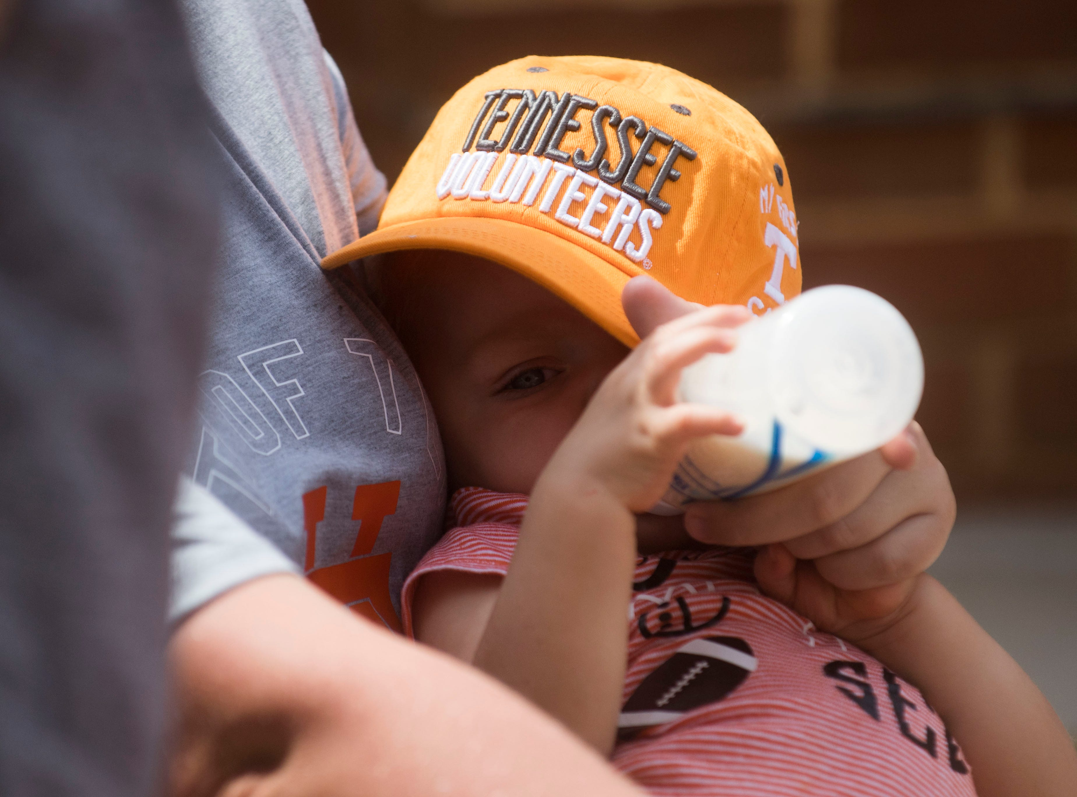 A young Vols fan has a snack before a Tennessee Vols football game against ETSU outside Neyland Stadium Saturday, Sept. 8, 2018.