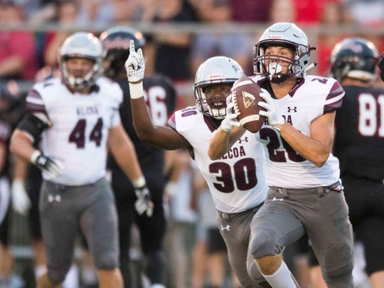 Alcoa's Shannon Mitchell (30) and Tyler Boyd (20) celebrate after recovering a Maryville fumble in the football game on Friday, September 7, 2018.