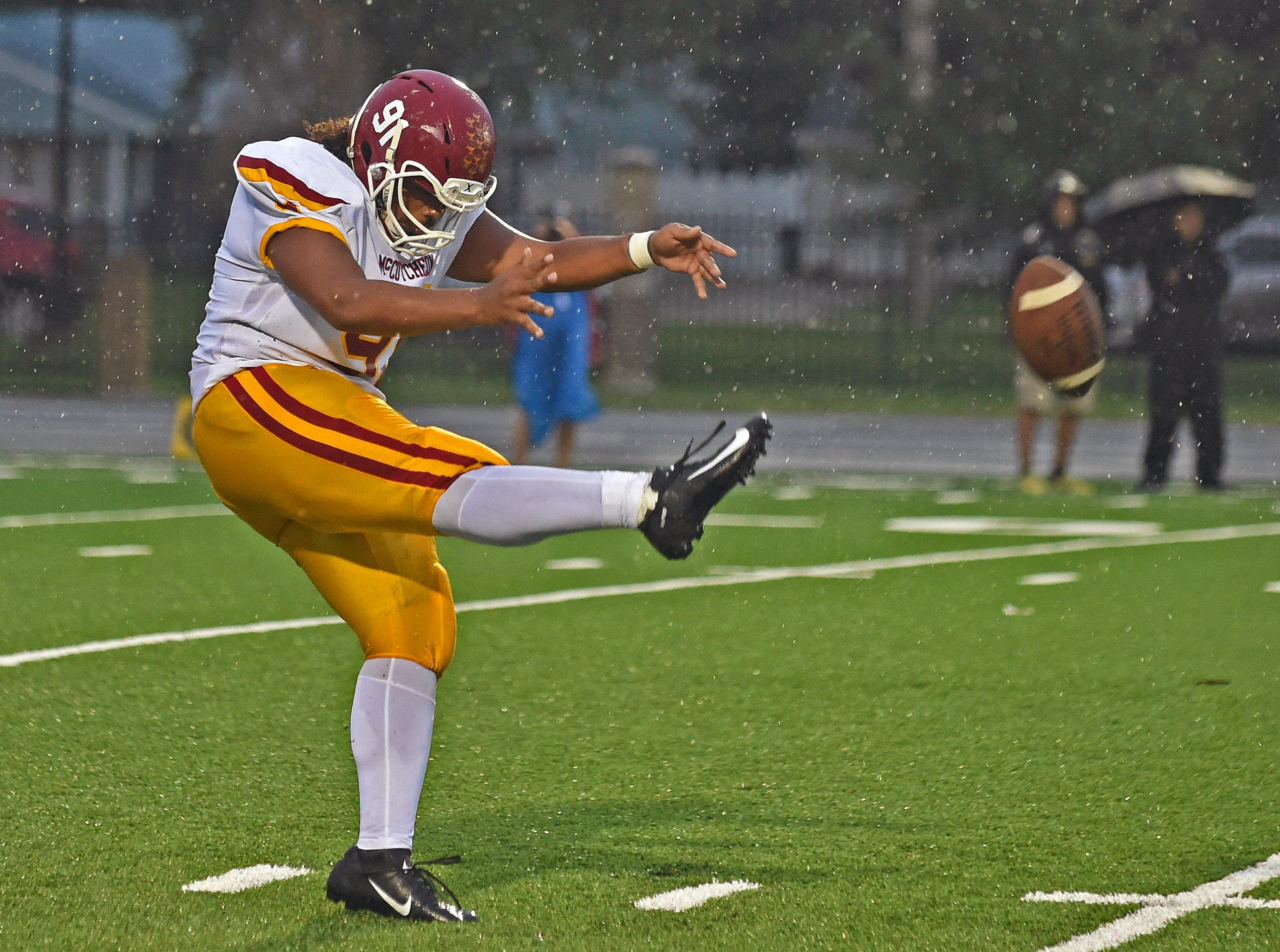 A rainy night of football in Kokomo as the Mavericks skin the Wildkats. Kenny Fields.