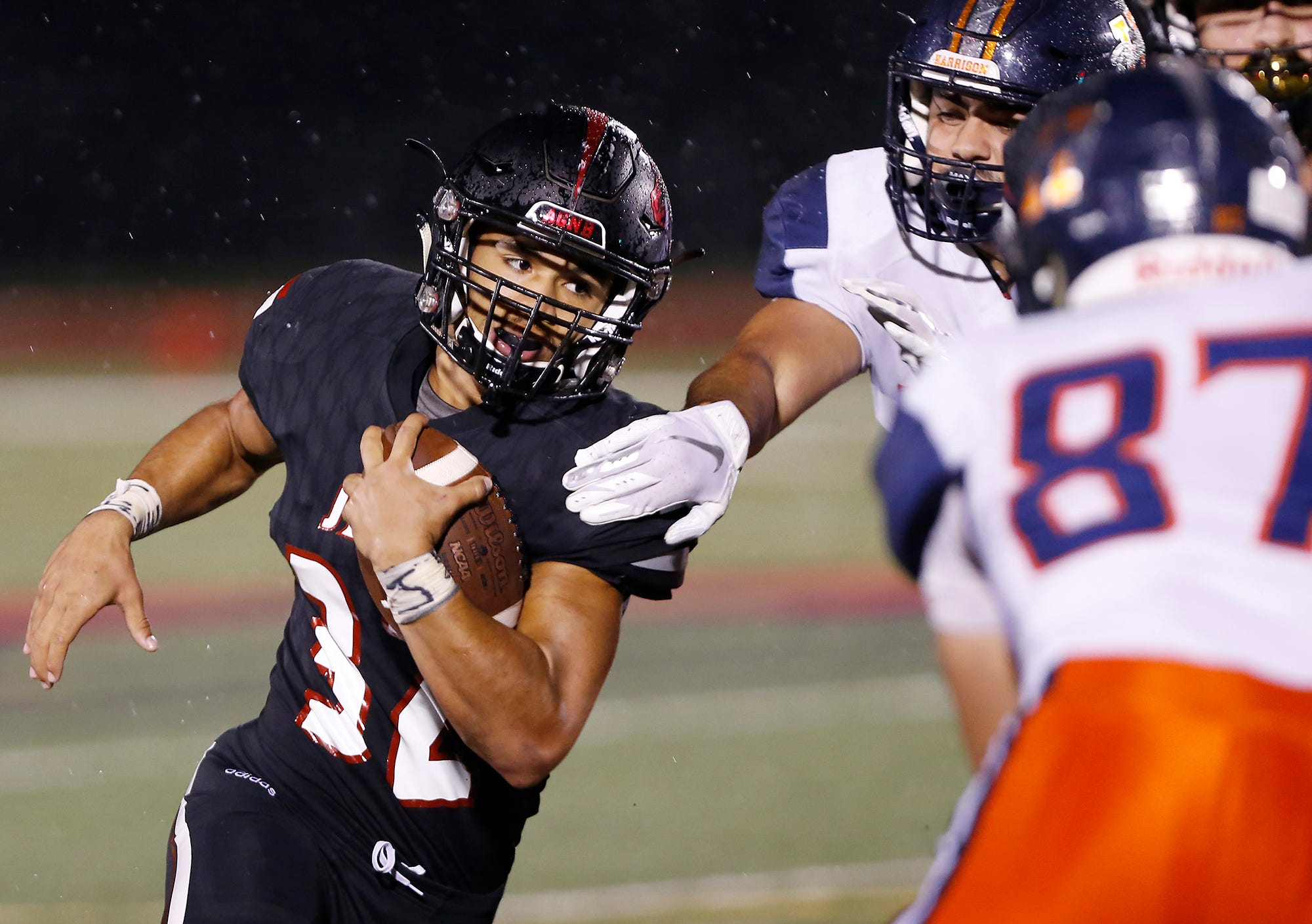 Marquis Munoz of Lafayette Jeff with a carry in the fourth quarter against Harrison Friday, September 7, 2018, at Scheumann Stadium. Jeff defeated Harrison 31-14.