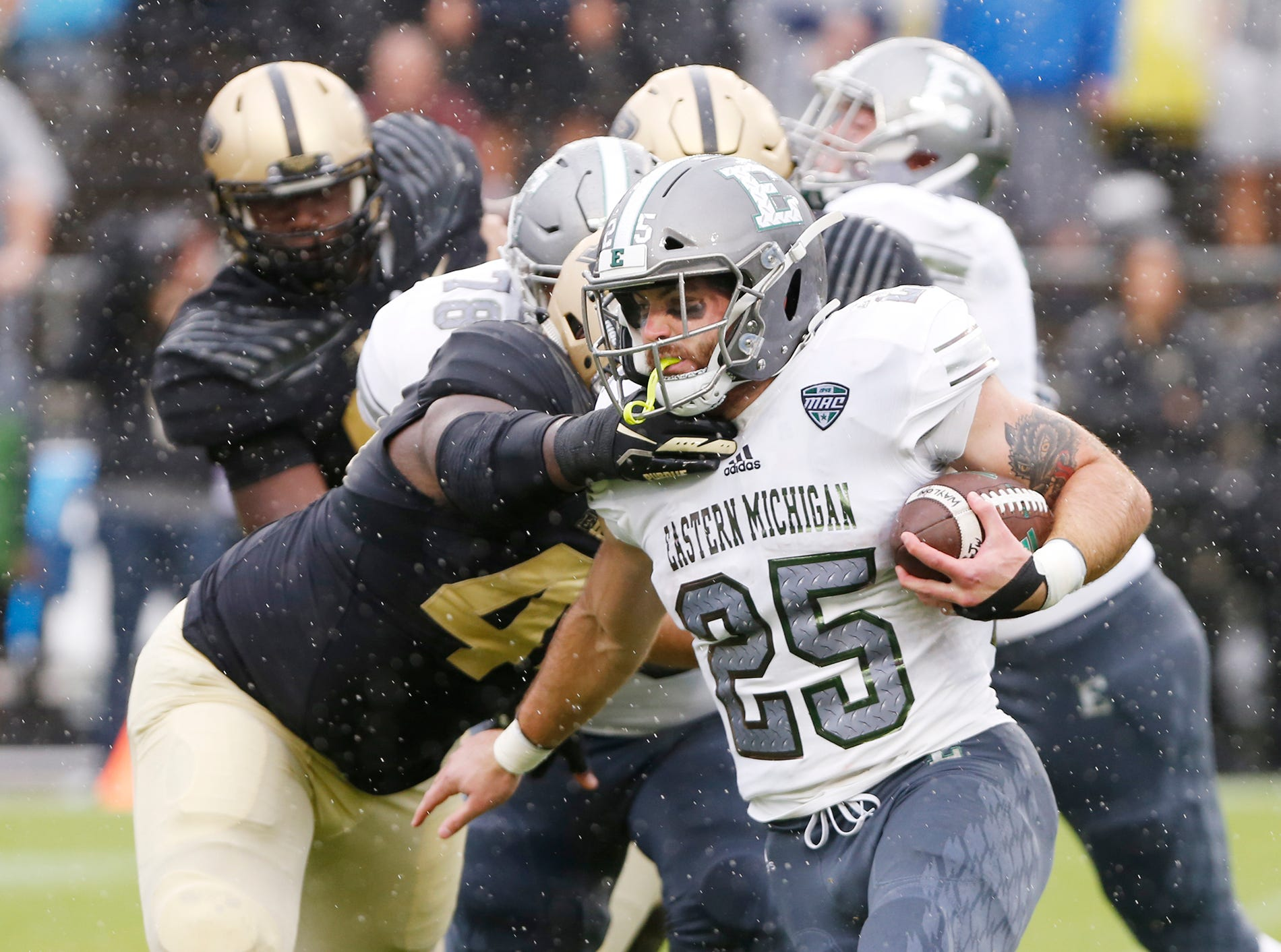 Ian Eriksen of Eastern Michigan with a first half carry against Purdue Saturday, September 8, 2018, in West Lafayette. Purdue fell to Eastern Michigan 20-19.
