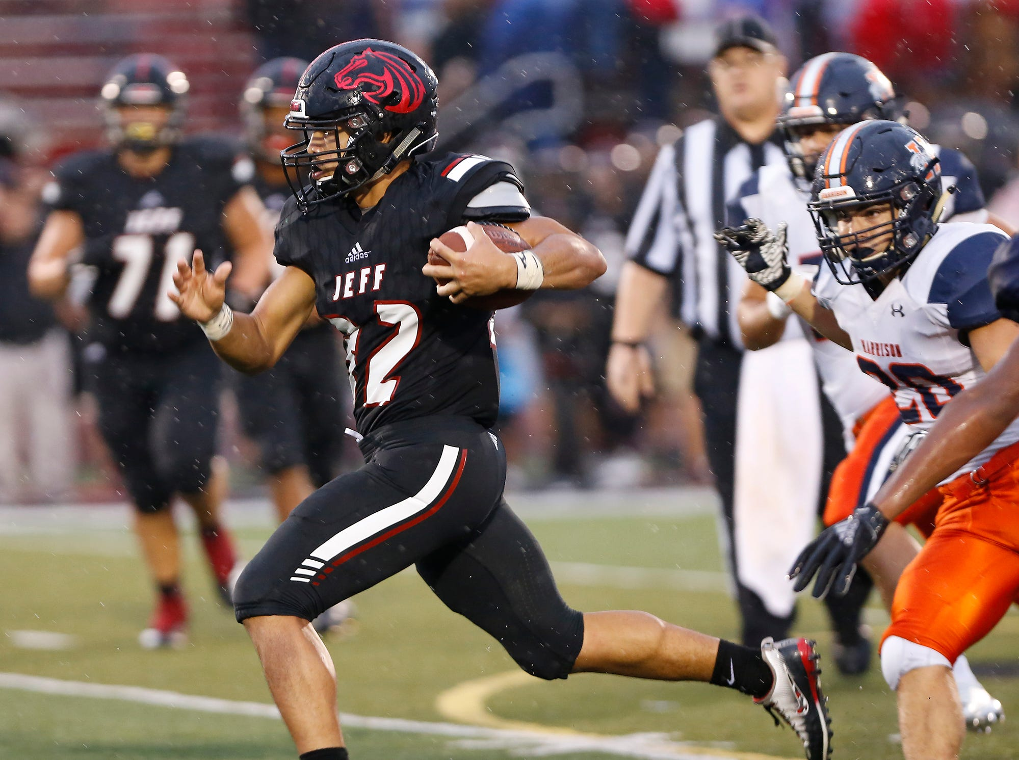 Marquis Munoz of Lafayette Jeff with a carry in the second quarter against Harrison Friday, September 7, 2018, at Scheumann Stadium. Jeff defeated Harrison 31-14.