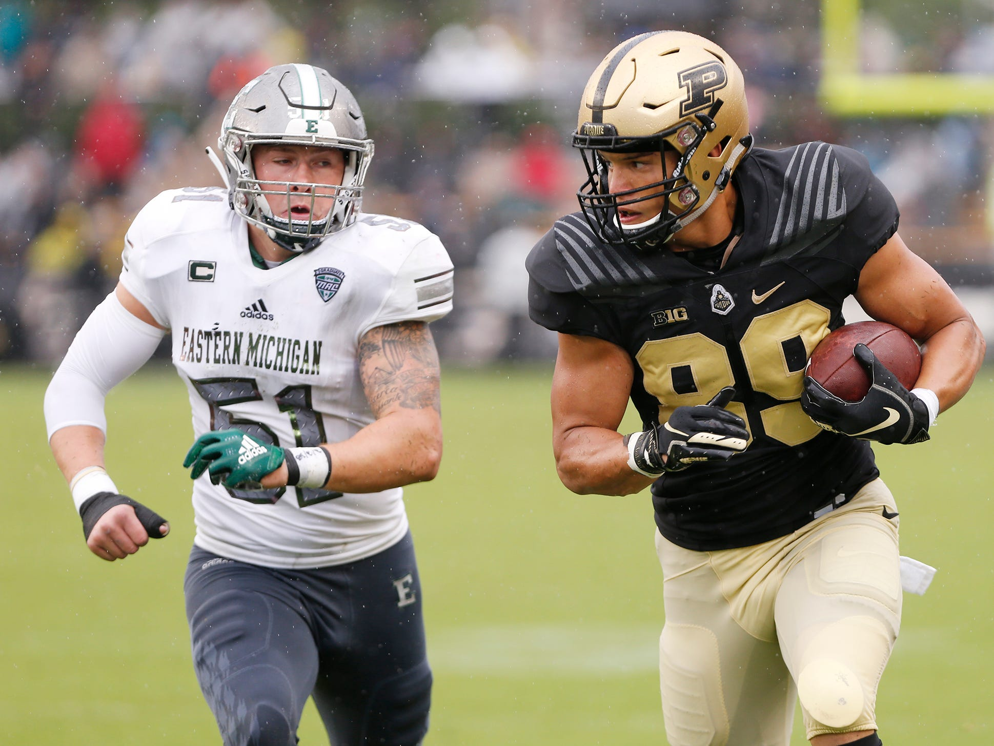 Purdue tight end Brycen Hopkins is chased by Kyle Rachwal of Eastern Michigan after a pass reception in the first half Saturday, September 8, 2018, in West Lafayette. Purdue fell to Eastern Michigan 20-19.