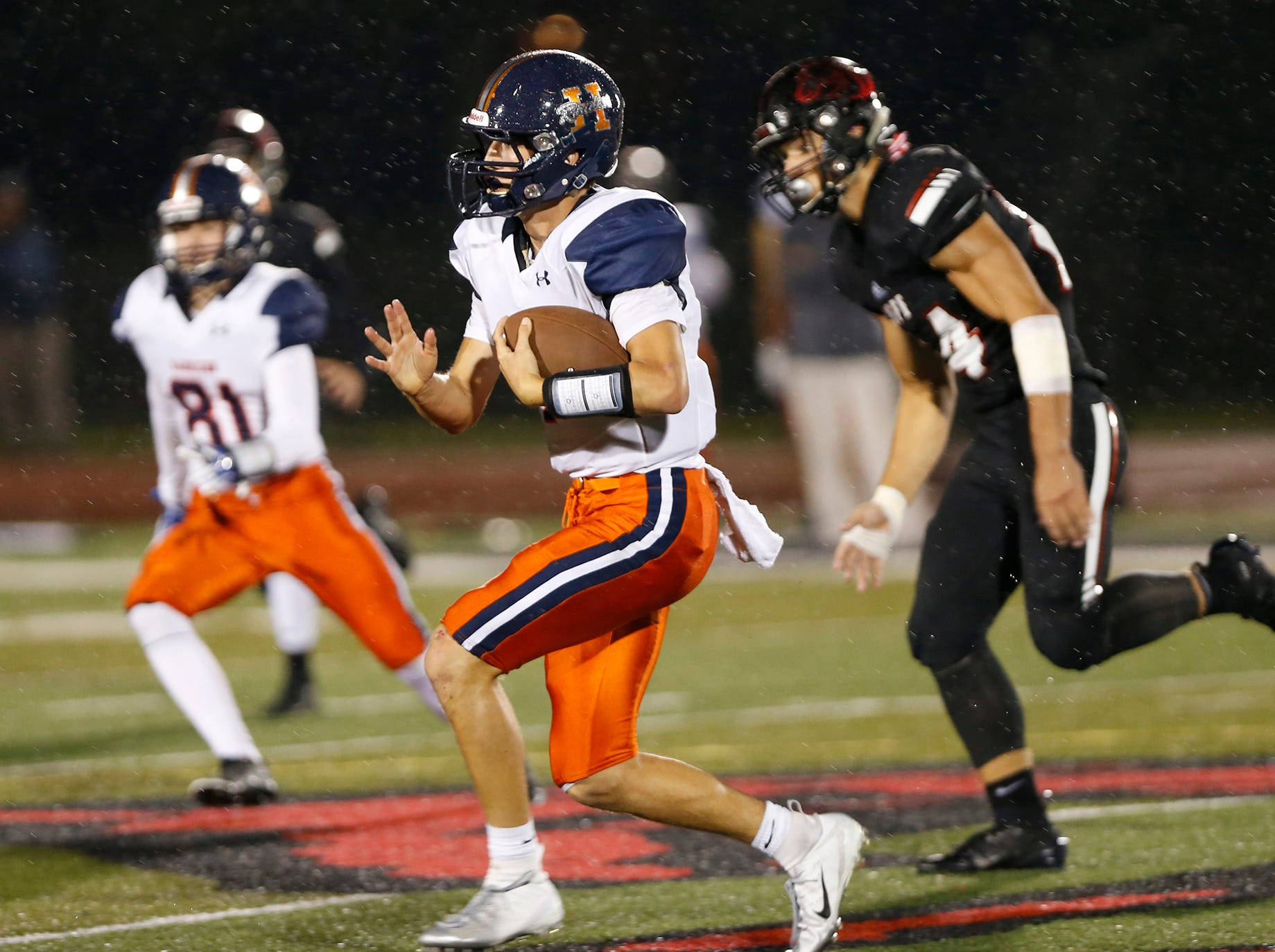 Harrison quarterback Andrew Jensen with a carry against Lafayette Jeff in the fourth quarter Friday, September 7, 2018, at Scheumann Stadium. Jeff defeated Harrison 31-14.