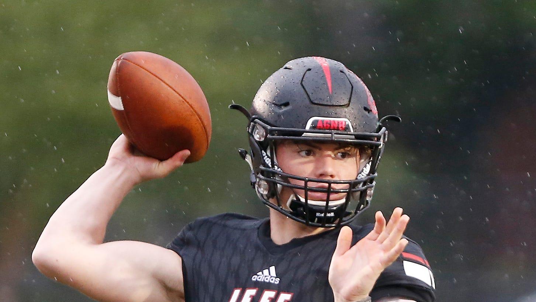 Lafayette Jeff quarterback Maximus Grimes with a pass against Harrison Friday, September 7, 2018, at Scheumann Stadium. Jeff defeated Harrison 31-14.