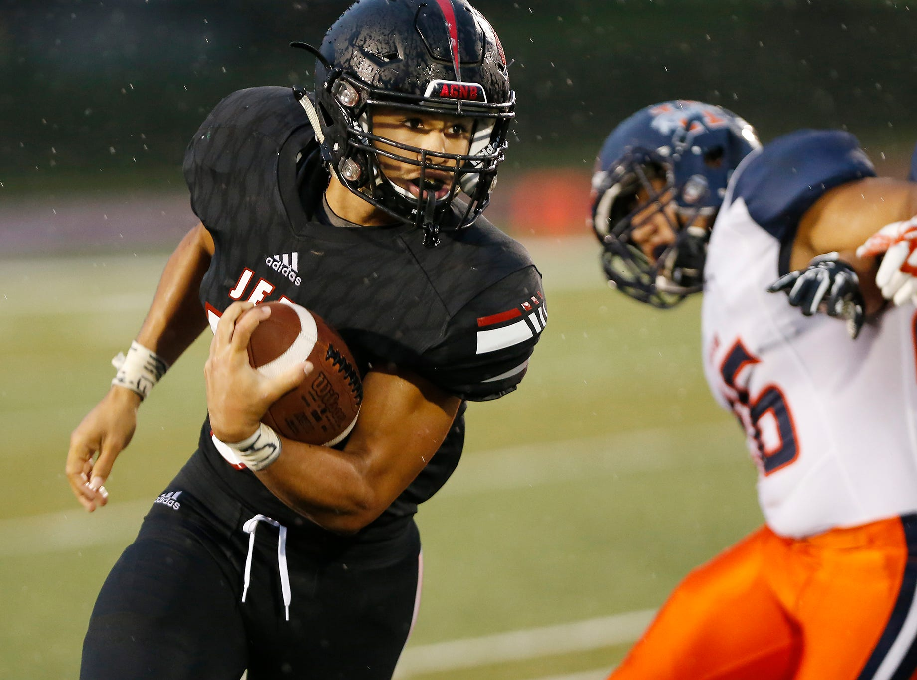 Marquis Munoz of Lafayette Jeff with a carry in the second quarter against Harrison Friday, September 7, 2018, at Scheumann Stadium.