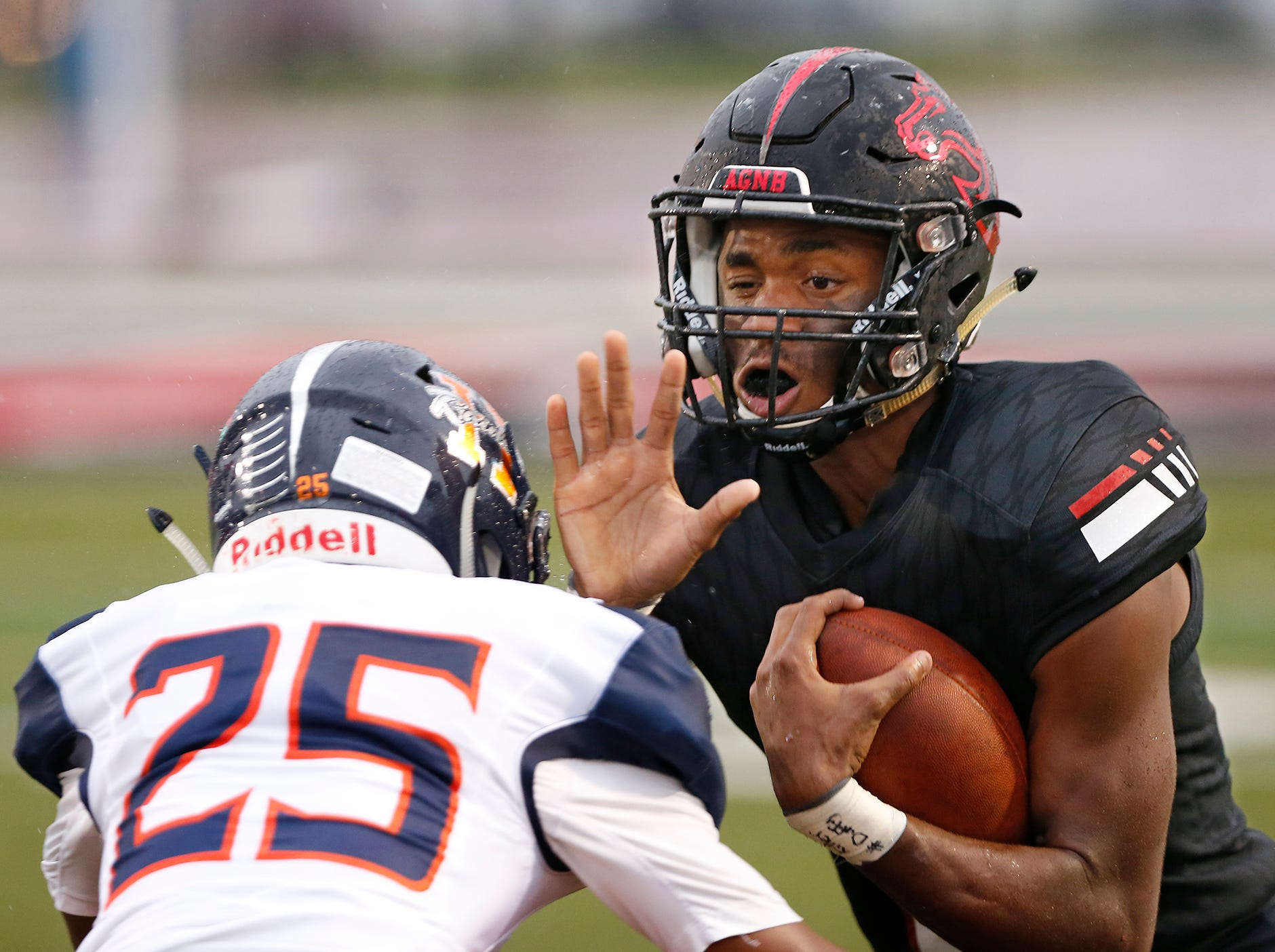 Lafayette Jeff wide receiver Derrick Matthews braces for the hit coming from Marcel Atisso of Harrison Friday, September 7, 2018, at Scheumann Stadium. Jeff defeated Harrison 31-14.