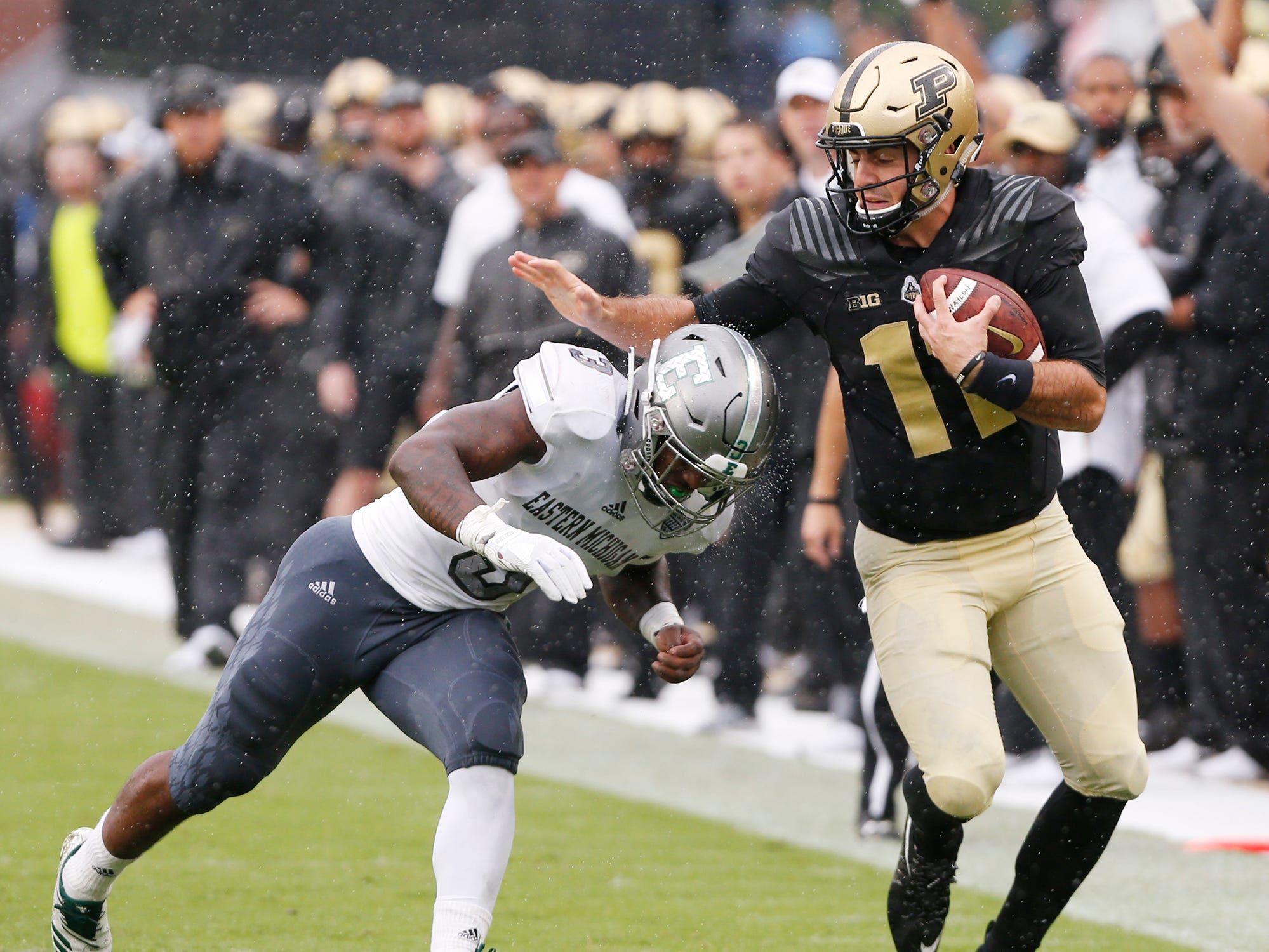 Purdue quarterback David Blough is chased down by Vince Calhoun of Eastern Michigan in the first half Saturday, September 8, 2018, in West Lafayette. Purdue fell to Eastern Michigan 20-19.