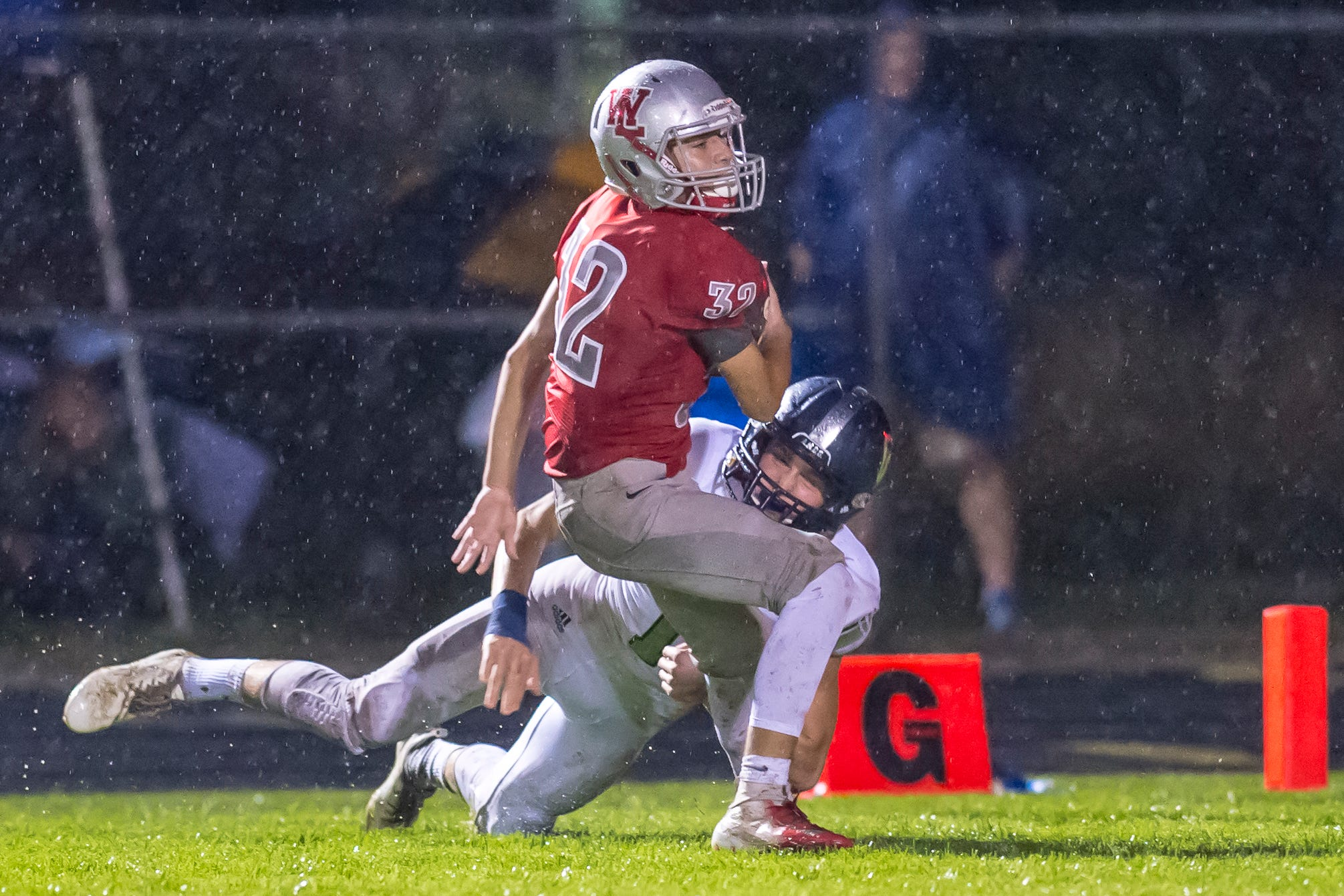 Sam Montes intercepts a Knight pass late in the West Lafayette vs. Central Catholic game.  Red Devils defeated the Knights 34-0.