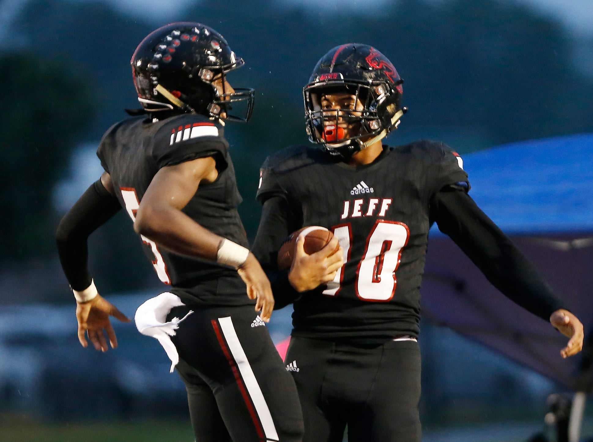 Zion Austin, right, of Lafayette Jeff celebrates with teammate Brian Jenkins after his second quarter touchdown reception against Harrison Friday, September 7, 2018, at Scheumann Stadium.