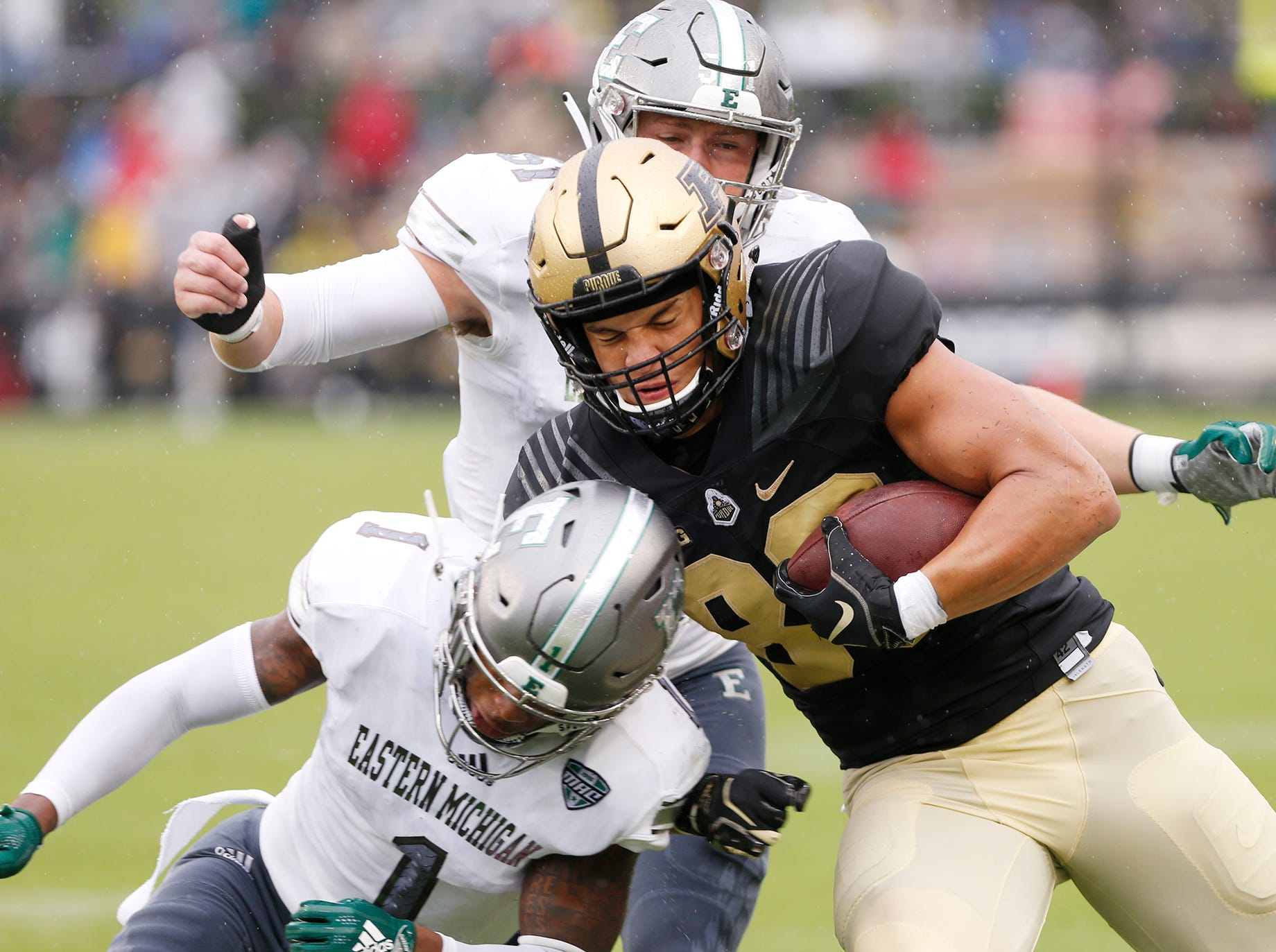 Purdue tight end Brycen Hopkins is brought down by Jalen Phelps and Kyle Rachwal of Eastern Michigan after a pass reception in the first half Saturday, September 8, 2018, in West Lafayette. Purdue fell to Eastern Michigan 20-19.