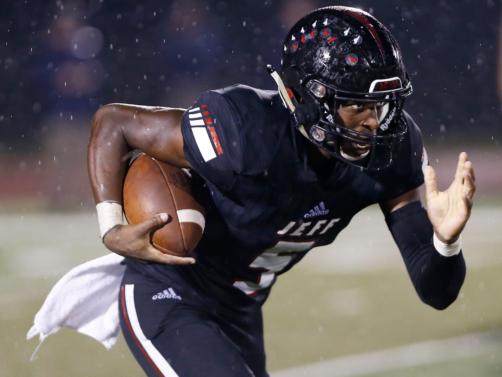 Brian Jenkins of Lafayette looks for running room after a pass reception against Harrison Friday, September 7, 2018, at Scheumann Stadium. Jeff defeated Harrison 31-14.