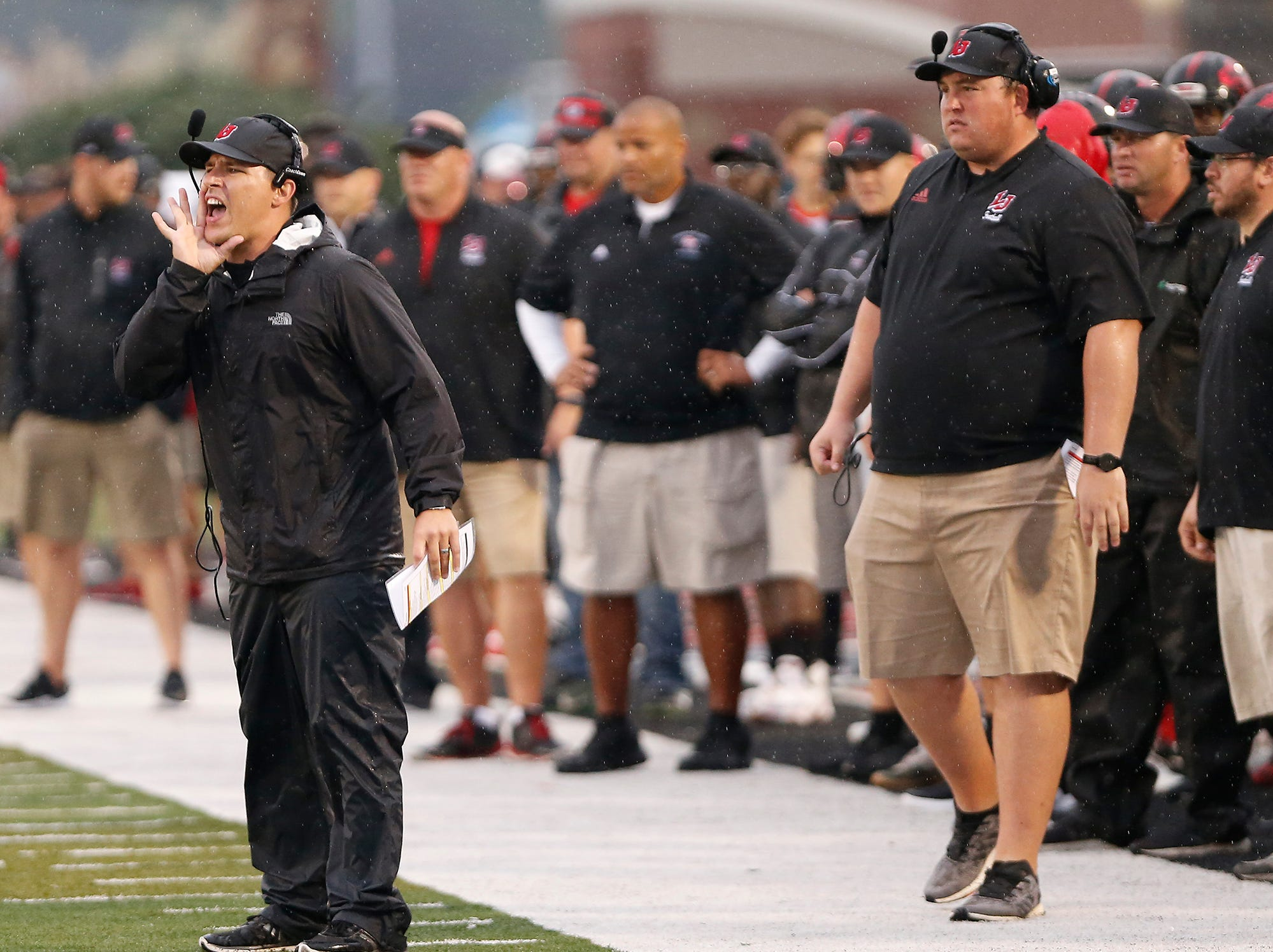 Lafayette Jeff head coach Pat Shanley shouts instructions to the Bronchos as they take the ball deep into Harrison territory in the first quarter Friday, September 7, 2018, at Scheumann Stadium. Jeff defeated Harrison 31-14.